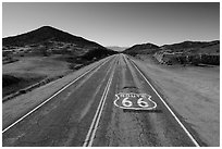 Aerial view of Route 66 with marker. Mojave Trails National Monument, California, USA ( black and white)