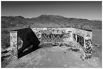Aerial view of abandonned structure with graffiti and route 66 marker. Mojave Trails National Monument, California, USA ( black and white)