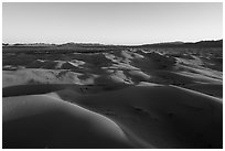Aerial view of Cadiz dunes and mountains at sunset. Mojave Trails National Monument, California, USA ( black and white)