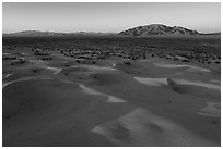 Aerial view of Cadiz dunes and mountain at sunset. Mojave Trails National Monument, California, USA ( black and white)