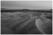 Aerial view of sand dunes and mountains at dusk, Cadiz Dunes. Mojave Trails National Monument, California, USA ( black and white)