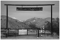 Entrance gate at dawn, Mission Creek Preserve. Sand to Snow National Monument, California, USA ( black and white)