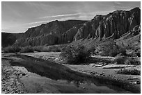 Afton Canyon cliffs reflected in shallow Mojave River. Mojave Trails National Monument, California, USA ( black and white)