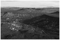 Aerial view of Black Lava Butte, boulders, and Flat Top Butte. Sand to Snow National Monument, California, USA ( black and white)