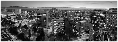 Downtown San Jose skyline and Santa Cruz Mountains at dusk. San Jose, California, USA (Panoramic black and white)