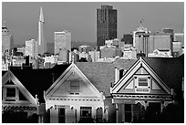 Victorians at Alamo Square and skyline, late afternoon. San Francisco, California, USA ( black and white)
