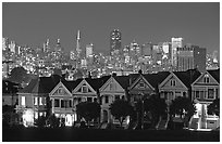 Victorians at Alamo Square and skyline, night. San Francisco, California, USA ( black and white)
