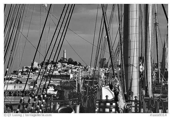 Telegraph Hill and Coit Tower seen through the masts of the Balclutha. San Francisco, California, USA