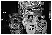 Lion dancers  during the Chinese New Year celebration. San Francisco, California, USA (black and white)