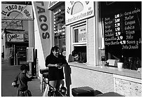Hispanic women at a taco shop. Redwood City,  California, USA (black and white)