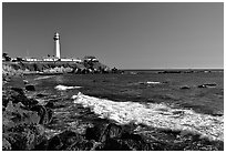Wave and Pigeon Point Lighthouse, afternoon. San Mateo County, California, USA (black and white)
