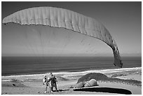 Paragliders practising in sand dunes, Marina. California, USA (black and white)