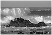 Crashing waves and rocks, Ocean drive. Pacific Grove, California, USA (black and white)