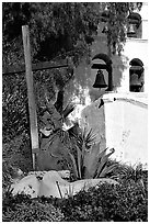 Cross, statue of father, belltower, Mission San Diego de Alcala. San Diego, California, USA (black and white)