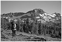 Backpacker  on trail towards Round Top. Mokelumne Wilderness, Eldorado National Forest, California, USA (black and white)