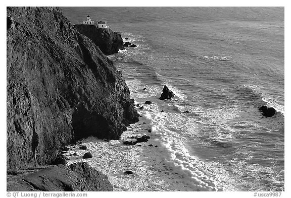 Cliffs, waves,  and Point Bonita Lighthouse, late afternoon. California, USA