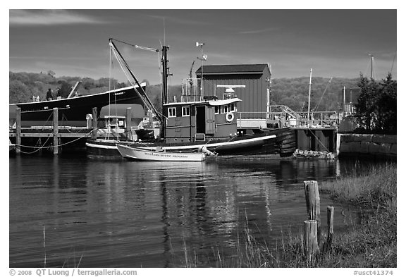 Boats and reflections at shipyard. Mystic, Connecticut, USA (black and white)