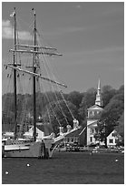 Tall ship and white steepled church. Mystic, Connecticut, USA (black and white)