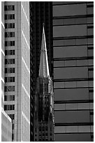 Church spire and modern buildings. Chicago, Illinois, USA (black and white)