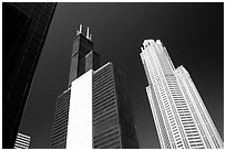 Sears tower and other skyscrappers towering in the sky. Chicago, Illinois, USA ( black and white)