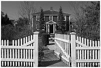 White picket fence and house, Provincetown. Cape Cod, Massachussets, USA (black and white)
