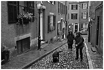 Women walking dog on rainy day, Beacon Hill. Boston, Massachussets, USA ( black and white)