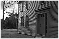 Historic house with grazing light, Minute Man National Historical Park. Massachussets, USA (black and white)