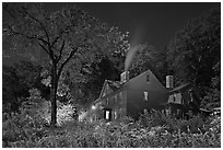 Orchard House at night with smoking chimney, Concord. Massachussets, USA (black and white)