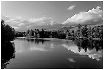 Calm Penobscot River reflects Katahdin range in the fall. Maine, USA (black and white)