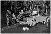 Hunters with moose in back of truck. Maine, USA (black and white)