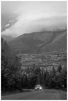 Truck on road below cloud-capped Katahdin. Maine, USA ( black and white)