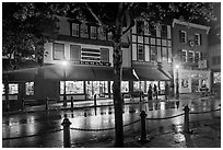 Street with wet pavement at night. Bar Harbor, Maine, USA ( black and white)