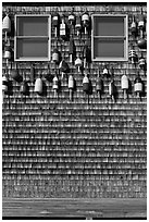 Facade decorated with buoys. Maine, USA (black and white)