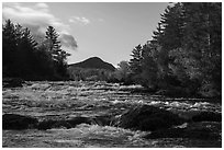 Haskell Rock Pitch cascades and Bald Mountain framed by trees in autumn foliage. Katahdin Woods and Waters National Monument, Maine, USA ( black and white)