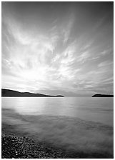 Clouds, surf, and islands near Grand Portage, sunrise. Minnesota, USA ( black and white)