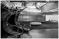 Curved moving staircase and meeeting room, Bloomberg building. NYC, New York, USA (black and white)