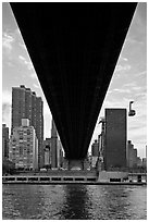 Queensboro bridge underside and tram. NYC, New York, USA (black and white)