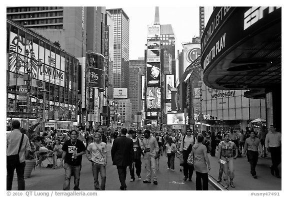 Crowds on Times Squares by day. NYC, New York, USA