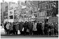 Gathering in Chinatown in winter. NYC, New York, USA (black and white)