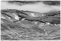 Painted hills with snow and fog. John Day Fossils Bed National Monument, Oregon, USA (black and white)