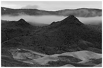 Buttes and fog at dusk. John Day Fossils Bed National Monument, Oregon, USA ( black and white)