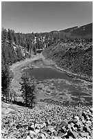 Pond at the edge of big obsidian flow. Newberry Volcanic National Monument, Oregon, USA (black and white)