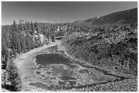 Pond at the edge of lava flow. Newberry Volcanic National Monument, Oregon, USA (black and white)