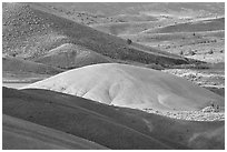Bare ash mounds and sagebrush-covered slopes. John Day Fossils Bed National Monument, Oregon, USA (black and white)