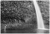 Woman in bikini at the base of Horsetail Falls. Columbia River Gorge, Oregon, USA ( black and white)