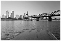 Deck, and Portland skyline with bridge at sunrise. Portland, Oregon, USA ( black and white)
