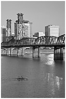 Double-oar rowboat and  Hawthorne Bridge. Portland, Oregon, USA ( black and white)