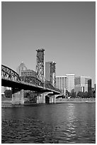 Williamette River at Hawthorne Bridge and high-rise buildings. Portland, Oregon, USA ( black and white)