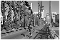 Bicyclist on Hawthorne Bridge. Portland, Oregon, USA ( black and white)