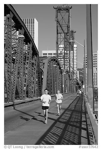 Men jogging on Hawthorne Bridge. Portland, Oregon, USA (black and white)